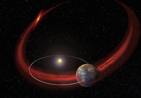 Mercury appears to undergo a recurring meteoroid shower when its orbit crosses the debris trail left by comet Encke. (Artist's concept.) (NASA/Goddard)
