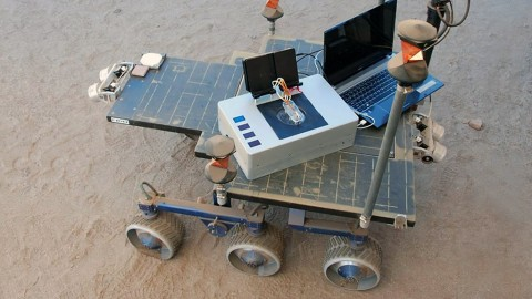 Researchers took the Chemical Laptop to JPL's Mars Yard, where they placed the device on a test rover. This image shows the size comparison between the Chemical Laptop and a regular laptop. (NASA/JPL-Caltech)
