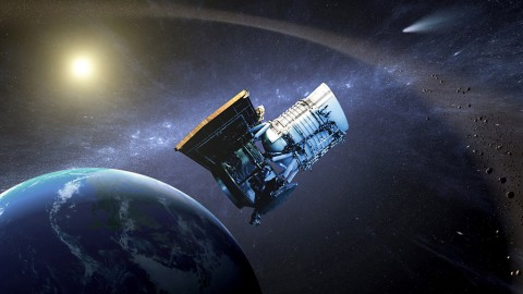 This artist's concept shows the Wide-field Infrared Survey Explorer, or WISE spacecraft, in its orbit around Earth. (NASA/JPL-Caltech)