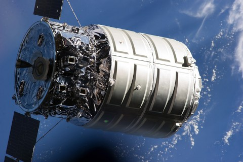 Close-up view of the approach to the International Space Station of the first Cygnus commercial cargo spacecraft built by Orbital ATK with the Earth in the background. (NASA)