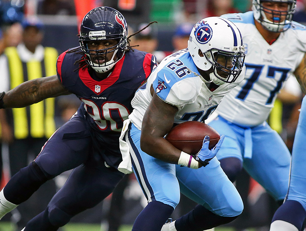 Tennessee Titans running back Antonio Andrews (26) rushes during the game against the Houston Texans at NRG Stadium. (Troy Taormina-USA TODAY Sports)