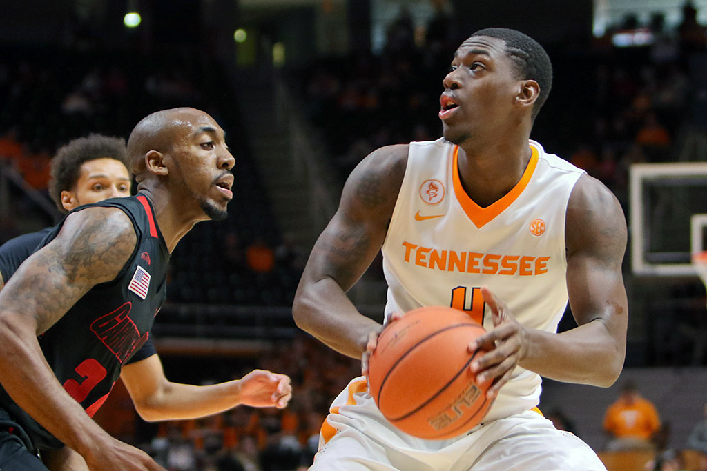 Tennessee Volunteers forward Armani Moore (4) moves the ball against Gardner Webb Runnin Bulldogs guard Isaiah Ivey (24) during the first half at Thompson-Boling Arena. (Randy Sartin-USA TODAY Sports)