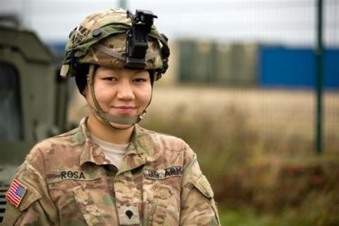 Soldiers serving in Germany discuss values, service, and sacrifice as Veterans Day, observed Nov. 11, approaches. Here, Army Spc. Judy Mera Rosa prepares to perform preventive maintenance checks and services with her comrade Sgt. Charles Roseboro during Exercise Combined Resolve V at the Joint Multinational Readiness Center in Hohenfels, Germany, Nov. 7, 2015. (Courtesy photo)