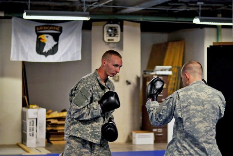 Spc. Christian L. Nielsen and Spc. Joshua M. Bareiszis, 2nd Brigade Combat Team, 101st Airborne Division (Air Assault), practice striking techniques at the 2nd Brigade Combat Team Combatives School here, Dec. 2, 2015. (U.S. Army Staff Sgt. Sierra A. Fown, 2nd Brigade Combat Team, 101st Airborne Division (Air Assault) Public Affairs)