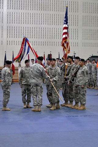 Command Sgt. Maj. Ramon Fisher, the outgoing command sergeant major for 326th Brigade Engineer Battalion, 1st Brigade Combat Team, 101st Airborne Division, passed the guidon to Lt. Col. Phillip Borders, outgoing commander, during their change of command and responsibility ceremony Feb. 5, 2015. Borders then passed the guidon to Lt. Col. Carl Bergmann, deputy commander of 1st BCT, signifying the end of their command of the Sapper Eagles. (Sgt. Samantha Parks, 1st Brigade Combat Team Public Affairs)