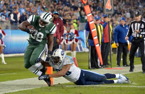 New York Jets running back John Conner (38) scores a touchdown against Tennessee Titans linebacker Wesley Woodyard (59) during the second half at LP Field. The Jets beat the Titans 16-11. (Don McPeak-USA TODAY Sports)