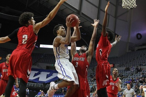 Austin Peay's Jared Savage (2), Chris Porter-Bunton (3) and Kenny Jones all converage on IPFW's Max Landis. (Aaron Suozzi)