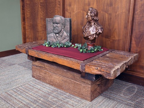 On display at Austin Peay State University's Woodward Library is a table made from salvaged material from the old Port Royal covered bridge. The table was created by Larry Ellis and Kenny Bishop, two APSU alums, in 1971. Also on the table are sculptures of founder of the Dewey Decimal system, Melvil Dewey (left) and author Johann Wolfgang von Goethe (right). (Scott Summate, APSU)