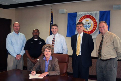 Clarksville Mayor Kim McMillan signs Memorandum of Understanding for the construction of a new splash pad and playground areas in Heritage Park.