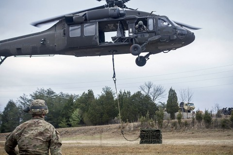 Soldiers with 2nd Battalion, 502nd Infantry Regiment, 2nd Brigade Combat Team, 101st Airborne Division (Air Assault), conduct sling load operations during a weeklong live-fire exercise at Fort Knox, Ky., Dec. 10, 2015. The training is in preparation for the brigade's upcoming 2016 deployment. (U.S. Army Staff Sgt. Terrance D. Rhodes, 2nd Brigade Combat Team, 101st Airborne Division (Air Assault) Public Affairs)