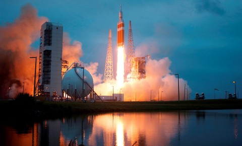 On Dec. 5, 2014, a Delta IV Heavy rocket lifts off from Space Launch Complex 37 at Cape Canaveral Air Force Station carrying NASA's Orion spacecraft on an unpiloted flight test to Earth orbit. During the two-orbit, four-and-a-half hour mission, engineers evaluated the systems critical to crew safety, the launch abort system, the heat shield and the parachute system. (NASA/Sandy Joseph & Kevin O'Connell)
