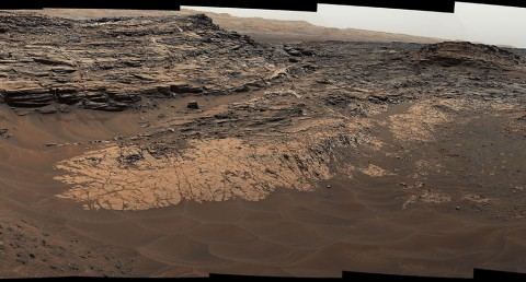 "This May 22, 2015, view from the Mast Camera (Mastcam) in NASA's Curiosity Mars rover shows the ""Marias Pass"" area where a lower and older geological unit of mudstone -- the pale zone in the center of the image -- lies in contact with an overlying geological unit of sandstone. (NASA/JPL-Caltech/MSSS)"