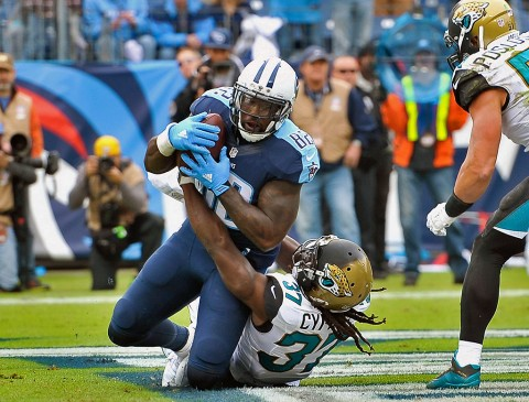 Tennessee Titans tight end Delanie Walker (82) scores a touchdown against Jacksonville Jaguars strong safety Johnathan Cyprien (37) during the first half at Memorial Gym. (Jim Brown-USA TODAY Sports)