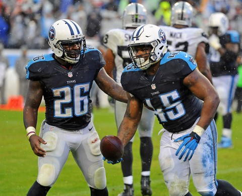 Tennessee Titans full back Jalston Fowler (45) celebrates with Tennessee Titans running back Antonio Andrews (26) after a touchdown during the second half at Nissan Stadium. The Raiders won 24-21. (Christopher Hanewinckel-USA TODAY Sports)