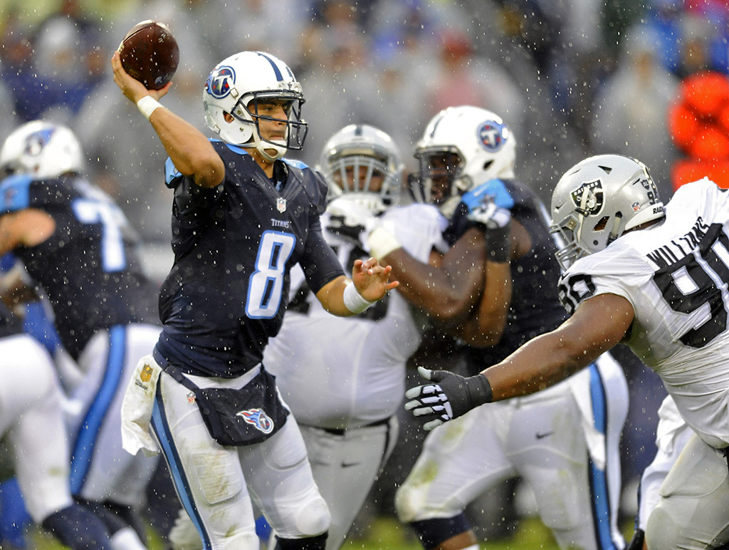 Tennessee Titans quarterback Marcus Mariota (8) attempts a pass during the second half against the Oakland Raiders at Nissan Stadium. The Raiders won 24-21. (Christopher Hanewinckel-USA TODAY Sports)