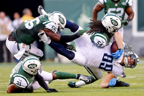 Tennessee Titans tight end Phillip Supernaw (89) is tackled by New York Jets linebacker Jamari Lattimore (54) and linebacker Demario Davis (56) and safety Marcus Gilchrist (21) during the fourth quarter at MetLife Stadium. The Jets defeated the Titans 30-8. (Brad Penner-USA TODAY Sports)