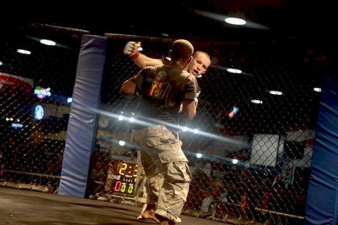 Spc. Christian L. Nielsen, 1st Battalion, 502nd Infantry Regiment, 2nd Brigade Combat Team, 101st Airborne Division, punches an opponent during the 2015 All-Armed Forces Combatives Competition at Fort Bragg, NC, Dec. 12, 2015. Nielsen took home 1st place for the second year in a row. (Courtesy Photo)