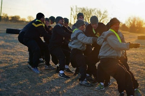 Lt. Col. Shawn Umbrell, commander, 1st Battalion, 502nd Infantry Regiment, 2nd Brigade Combat Team, 101st Airborne Division (Air Assault) leads Soldiers within his battalion during a tug-of-war game here, Jan. 13. The tug-of-war was a part of the chaplain's challenge- an event that was geared to incorporate both physical training and the Value of Life. (Staff Sgt. Sierra A. Fown, 2nd Brigade Combat Team, 101st Airborne Division (Air Assault)