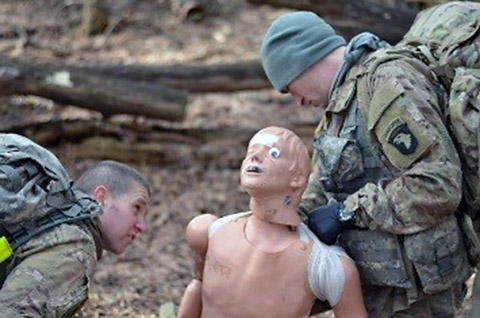 """Sgt. Ethan Lambert and Spc. David Hull, combat medics, 1st Battalion, 502nd Infantry Regiment, Strike, evaluate a casualty during the battalion's best medic competition at Fort Campbell, Ky., Jan. 14, 2016. The two """"First Strike"""" Soldiers were the winners of the competition. (Staff Sgt. Sierra A. Fown, 2nd Brigade Combat Team, 101st Airborne Division (Air Assault) Public Affairs)"""