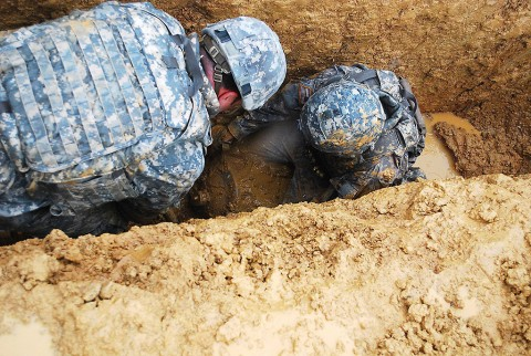 U.S. Army Soldiers, assigned to the 52nd Ordnance Group (Explosive Ordnance Disposal), use a hand-held scanner to locate buried training ordnance and subsequently identify and render it safe during an annual explosive ordnance disposal competition held on Fort Knox, KY, April 16th, 2015. (U.S. Army photo by Rachael Tolliver)