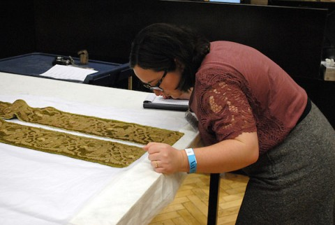APSU student Macon St. Hilaire examining embroidery during her trip to London.