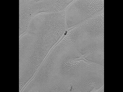 """Transmitted to Earth on Dec. 24, 2015, this image from the Long Range Reconnaissance Imager (LORRI) extends New Horizons' highest-resolution swath of Pluto to the center of Sputnik Planum, the informally named plain that forms the left side of Pluto's """"heart."""" Mission scientists believe the pattern of the cells stems from the slow thermal convection of the nitrogen-dominated ices. (NASA/JHUAPL/SwRI)"""