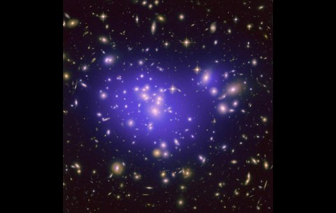 This image from NASA's Hubble Space Telescope shows the inner region of Abell 1689, an immense cluster of galaxies. Scientists say the galaxy clusters we see today have resulted from fluctuations in the density of matter in the early universe. (NASA/ESA/JPL-Caltech/Yale/CNRS)