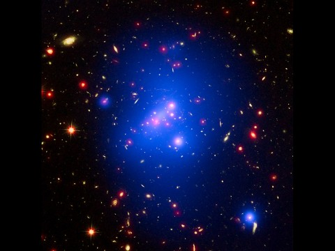 Astronomers have made the most detailed study yet of an extremely massive young galaxy cluster using three of NASA's Great Observatories. (NASA/CXC/Univ of Missouri/M.Brodwin et al; NASA/STScI; JPL/CalTech)