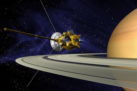 This is an artists concept of Cassini during the Saturn Orbit Insertion (SOI) maneuver, just after the main engine has begun firing. (NASA/JPL)