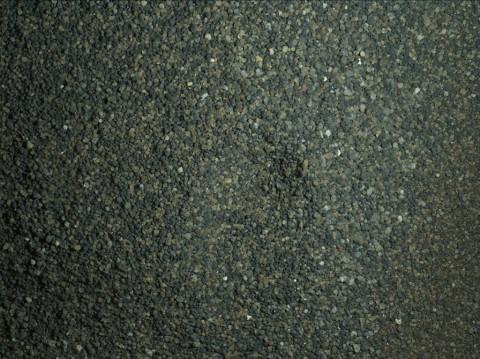 The Mars Hand Lens Imager (MAHLI) camera on the robotic arm of NASA's Curiosity Mars rover used electric lights at night on Jan. 22, 2016, to illuminate this postage-stamp-size view of Martian sand grains dumped on the ground after sorting with a sieve. (NASA/JPL-Caltech/MSSS)