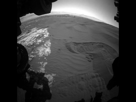 This view captures Curiosity's current work area where the rover continues its campaign to study an active sand dune on Mars. This site is part of the Bagnold Dunes, a band of dark sand dunes along the northwestern flank of Mars' Mount Sharp. (NASA/JPL-Caltech)