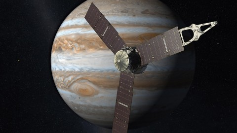 Launched from Earth in 2011, the Juno spacecraft will arrive at Jupiter in 2016 to study the giant planet from an elliptical, polar orbit. Juno will repeatedly dive between the planet and its intense belts of charged particle radiation, coming only 5,000 kilometers (about 3,000 miles) from the cloud tops at closest approach. (NASA/JPL-Caltech)