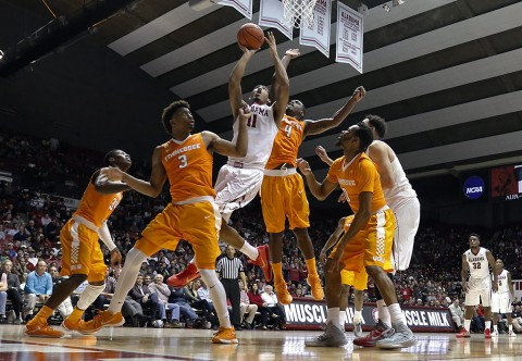 Alabama Crimson Tide forward Shannon Hale (11) goes up for a shot and is fouled by Tennessee Volunteers forward Armani Moore (4) during the second half at Coleman Coliseum. Alabama won 63-57. (Butch Dill-USA TODAY Sports)