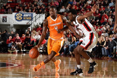 Tennessee Volunteers forward Armani Moore (4) is guarded by Georgia Bulldogs guard William Jackson II (0) during the first half at Stegeman Coliseum. (Dale Zanine-USA TODAY Sports)