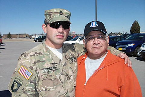 Staff Sgt. Tomas Rodriguez Jr., a squad leader with the 1st Battalion, 26th Infantry Regiment, 2nd Brigade Combat Team, 101st Airborne Division poses for a photo with his father, retired Staff Sgt. Tomas Rodriguez, at Fort Campbell, in 2013. Rodriguez Sr. also served in the 101st Airborne Division. (Courtesy Photo)