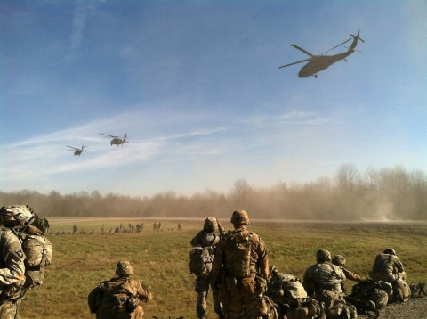 Soldiers from 1st Battalion, 26th Infantry Regiment, 2nd Brigade Combat Team, 101st Airborne Division (Air Assault) prepare to be picked up by UH-60 Black Hawk helicopters before an air assault mission at Fort Knox, Ky., Dec. 9, 2015. (1st Lt. Daniel Johnson, 1st Battalion, 26th Infantry Regiment, 2nd Brigade Combat Team, 101st Airborne Division)