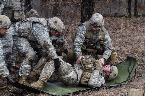Medics with Company C, 1st Battalion, 327th Infantry Regiment, 1st Brigade Combat Team, 101st Airborne Division (Air Assault) move a notionally injured Soldier to a litter during the live fire exercise Feb. 17, 2016, at Range 55, Fort Campbell, KY. (Sgt. Samantha Stoffregen, 1st Brigade Combat Team, 101st Airborne Division (Air Assault) Public Affairs)