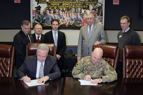 John Mahre, [left] on behalf of the Hopkinsville Christian County Industrial Development Authority and Col. James R. Salome, Fort Campbell's Garrison Commander, sign a memorandum of agreement Thursday to lay the framework for providing rail access via the Army railroad to the Hopkinsville Megasite, located just north of I-24. Also in attendance are Hopkinsville Mayor Carter Hendricks, Jack Lackey, Secretary of the industrial authority Nate Pagan, Steve Tribble and James Duttweiler. (Leejay Lockhart, Fort Campbell Public Affairs Office)