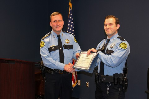 Montgomery County Sheriff John Fuson gives Deputy Ethan Moss a commendation for saving a man's life.