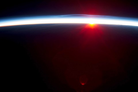 Earth's atmosphere viewed from the International Space Station. A NASA/Duke University study provides new evidence that natural cycles alone aren't sufficient to explain the global atmospheric warming observed over the last century. (NASA)