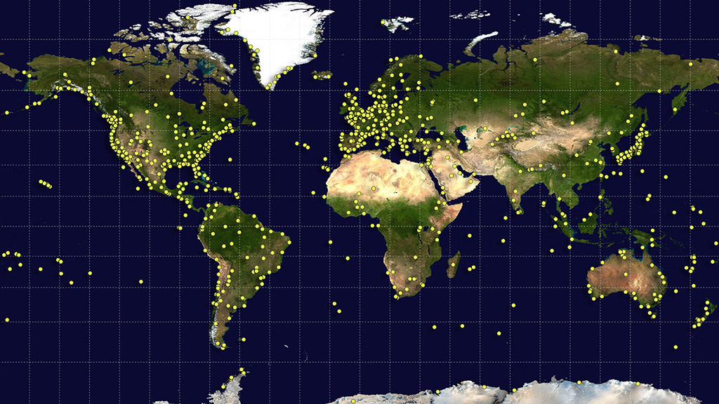 Sites around the world (yellow dots) contributed data and serve as