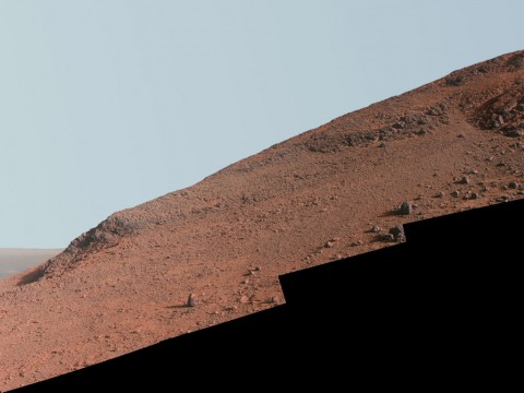"This scene from NASA's Mars Exploration Rover Opportunity looks upward at ""Knudsen Ridge"" from the valley below. (NASA/JPL-Caltech/Cornell Univ./Arizona State Univ.)"
