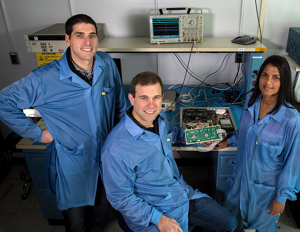 Jared Lucey, Jeffrey Piepmeier, and Priscilla Mohammed, a research engineer at Morgan State University, are developing a new CubeSat mission to test RFI-mitigation strategies. They are shown here with a testbed for testing mitigation algorithms. (Bill Hrybyk/NASA)