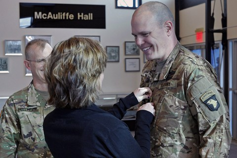 Lt. Col. Cory Mulhern, a liaison officer for the 101st Airborne Division (Air Assault), smiles at his daughter, Sierra, as she pins on his rank during his promotion ceremony in the division headquarters, Fort Campbell, Ky., Feb. 11, 2016. (Sgt. 1st Class Nathan Hoskins 101st Airborne Division Public Affairs)