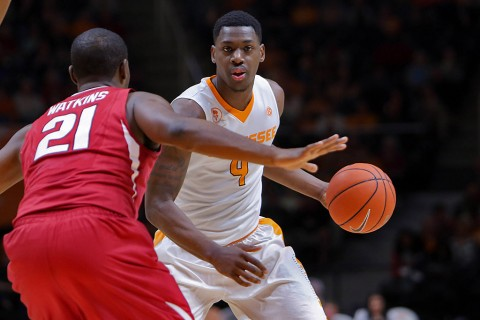 Tennessee Volunteers forward Armani Moore (4) brings the ball up court against Arkansas Razorbacks guard Manuale Watkins (21) during the second half at Thompson-Boling Arena. Arkansas won 75 to 65. (Randy Sartin-USA TODAY Sports)