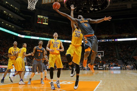 Tennessee Volunteers forward Armani Moore (4) shoots the ball past LSU Tigers forward Craig Victor II (32) at Thompson-Boling Arena. The Volunteers won 81 to 65. (Randy Sartin-USA TODAY Sports)