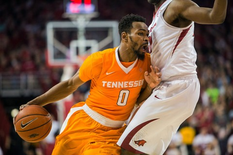 Tennessee Volunteers guard Kevin Punter Jr. (0) dribbles into Arkansas Razorbacks forward Moses Kingsley (33) during the second half of play at Bud Walton Arena. The Razorbacks won 85-67. (Gunnar Rathbun-USA TODAY Sports)