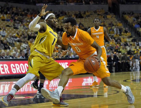 Tennessee Volunteers guard Kevin Punter Jr. (0) drives past Missouri Tigers guard Terrence Phillips (1) during the first half of a game at Mizzou Arena. (Timothy Tai-USA TODAY Sports)