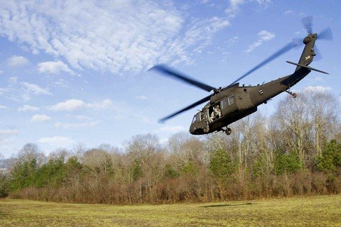A UH-60 with Soldiers from 58th Signal Company, 101st Special Troops Battalion, 101st Airborne Division (Air Assault) takes off from training area 12 to transport the Soldiers so they can commence their week long training exercise on Fort Campbell, Ky., March 14, 2016. (U.S. Army Sgt. Neysa Canfield, 101st Sustainment Brigade Public Affairs)