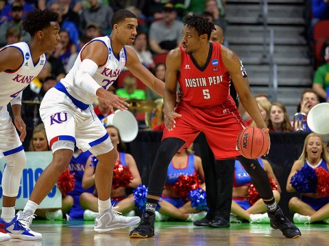 Austin Peay Governors center Chris Horton (5) handles the ball against Kansas Jayhawks forward Landen Lucas (33) during the first half in the first round of the 2016 NCAA Tournament at Wells Fargo Arena. (Steven Branscombe-USA TODAY Sports)